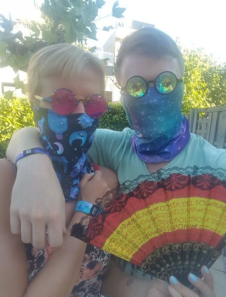 a male and a female wear some common rave accessories