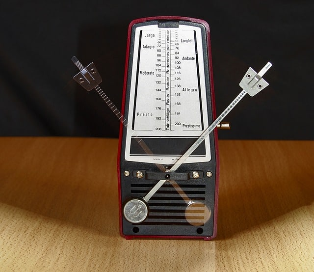 A moving metronome visible in two positions